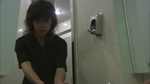 ms man entering public restroom and washing hands, beijing, china - public restroom stock videos and b-roll footage
