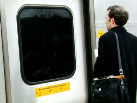 ms, man entering train, chappaqua, new york state, usa - one mature man only stock-videos und b-roll-filmmaterial
