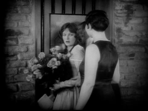 ms, b&w, man entering woman's room, 1920's  - bianco e nero video stock e b–roll
