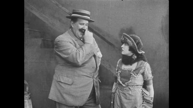 1921 Man (Joe Roberts) enters house through cellar door in time to catch woman (Virginia Fox) as she falls through trapdoor