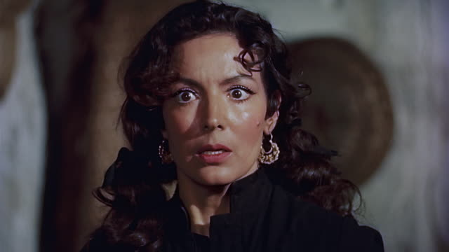 vidéos et rushes de man enters the room and tries to abuse a woman. they fight and she gets away. man leaves to room. featuring mexican icon maria felix. - pression physique