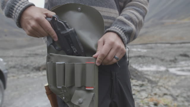 man examines flare gun, slow motion - gun stock videos & royalty-free footage