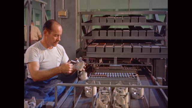 vídeos de stock e filmes b-roll de ms man examining at production line in factory / united states - só um homem de idade mediana