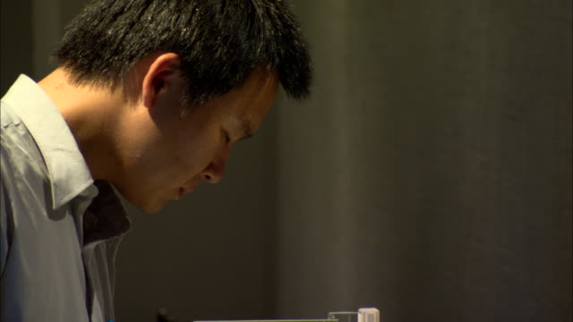 cu tu td man examining model of power plant on display at shanghai scientific energy conservation exhibition hall at shanghai energy resource center, shanghai, china - architectural model stock videos and b-roll footage