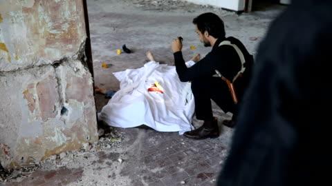 man examining murder victim - murder victim stock videos & royalty-free footage