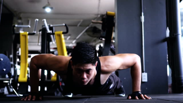 man exercising at the gym, video slow motion - health club stock videos & royalty-free footage