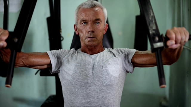 man exercising in a gymnasium - picking up stock videos & royalty-free footage