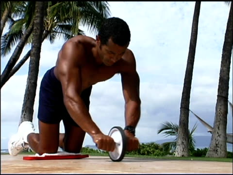 man exercising with ab roller - one mid adult man only stock videos & royalty-free footage