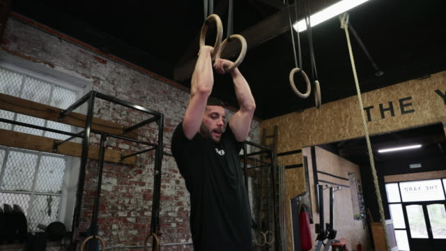 man exercising with gymnastic rings - cross trainer stock videos & royalty-free footage