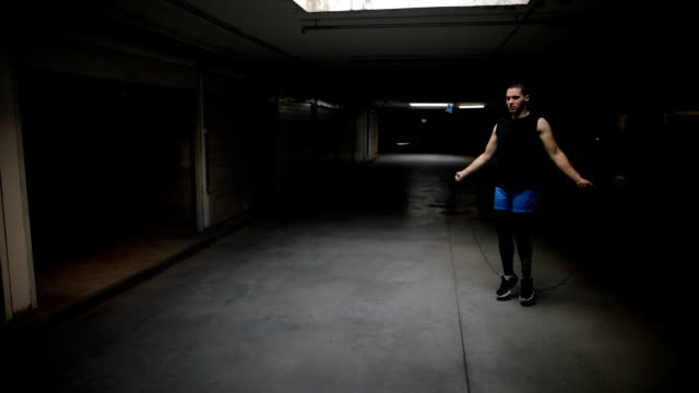 man exercising with jump-rope indoors - warming up stock videos & royalty-free footage