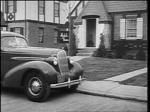 b/w 1935 man exiting car in front of house / educational - 1935 stock videos & royalty-free footage
