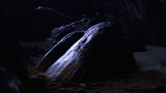 man explores beach cave, cornwall, uk - adventure stock videos & royalty-free footage