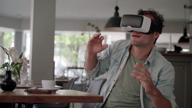 man explores his hi-end vr-headset in a coffeehouse - one mid adult man only stock videos & royalty-free footage