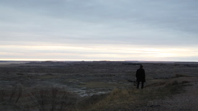 man exploring badlands national park - badlands national park stock videos & royalty-free footage