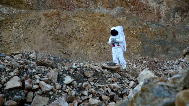 Man exploring rocky Mars