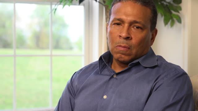 Man Expresses Concern and Sorrow Looking at Camera b