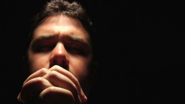 man face closeup praying