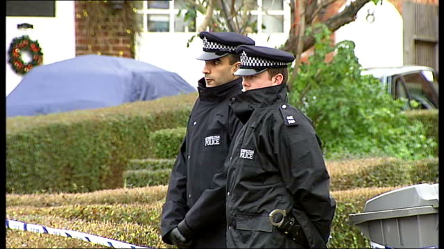 Man faces charges of assaulting two police officers ENGLAND London Wembley EXT Police vans and police officers on duty outside semidetached house