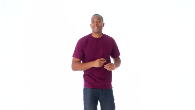 vidéos et rushes de man facing camera and dancing - 25 29 ans