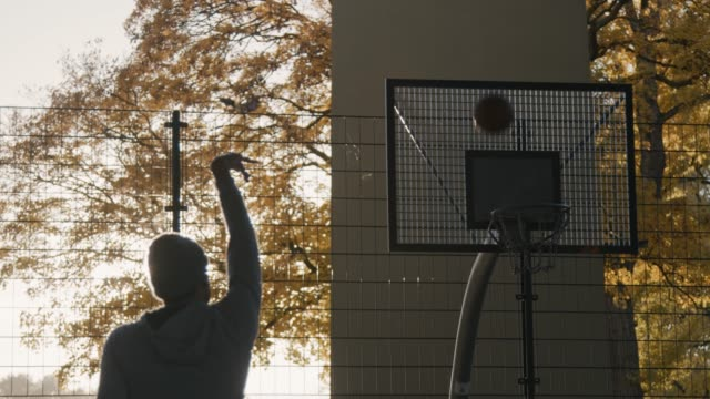 man failing to score while playing basketball - defeat stock videos & royalty-free footage