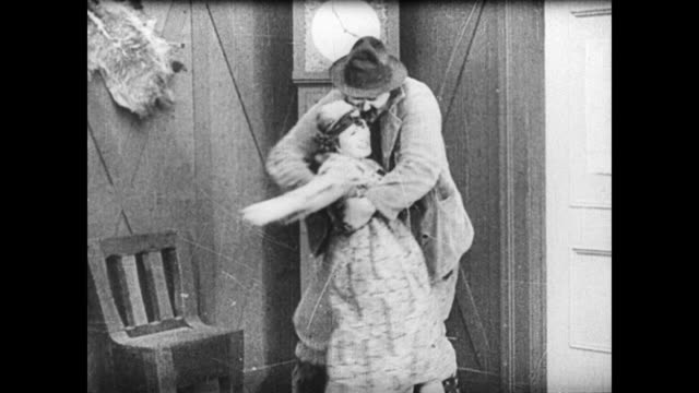 1921 man (buster keaton) fails at trying to save a woman (virginia fox) from lizard lip luke (joe roberts) and is thrown out of the lodge - 1921 stock videos & royalty-free footage