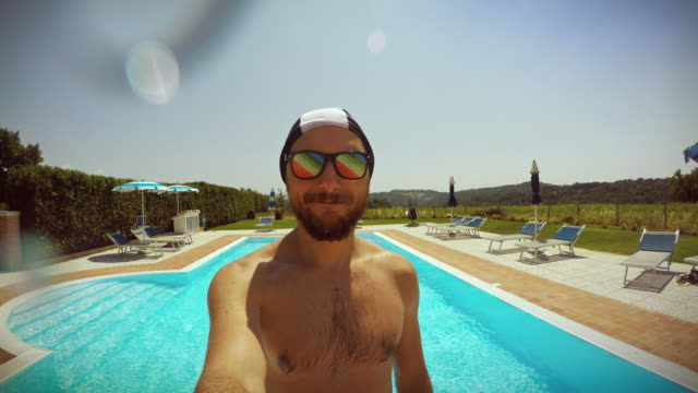 Man falling in swimming pool
