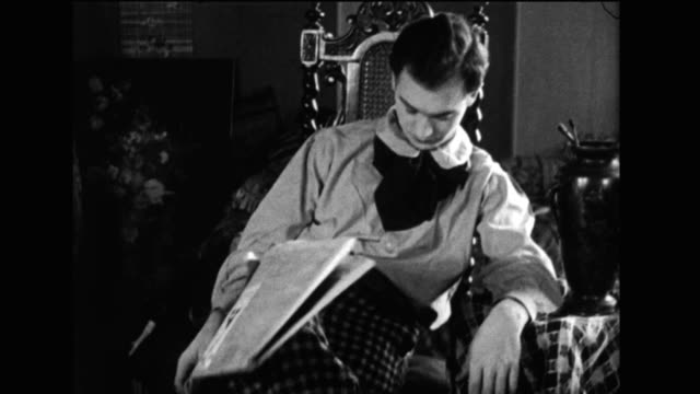 stockvideo's en b-roll-footage met a man falls asleep reading the newspaper - moe