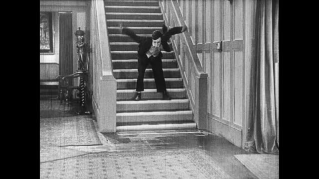 1922 man (buster keaton) falls down electrified stairway - falling stock videos & royalty-free footage