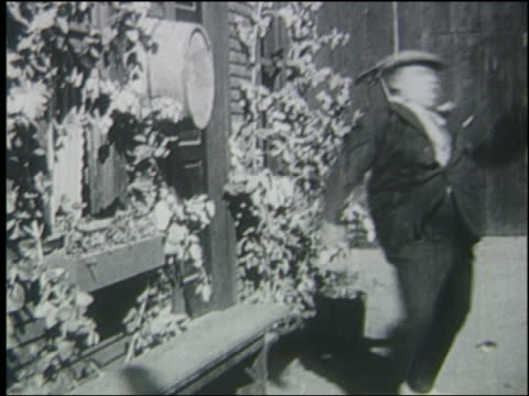 B/W 1914 man (Fatty Arbuckle) falls on bench + it collapses