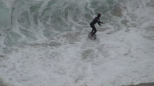 man falls on skim board in huge waves - skimboard stock videos and b-roll footage