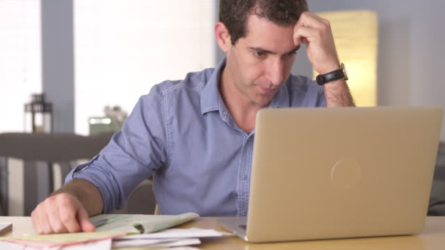 man feeling frustrated with bills - debt stock videos & royalty-free footage