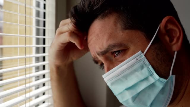 vídeos de stock e filmes b-roll de man feeling lonely during coronavirus epidemic - anxiety
