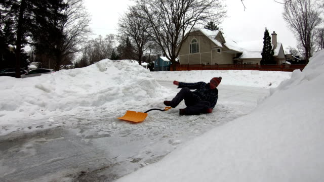 man fell with snow shovel - driveway stock videos & royalty-free footage
