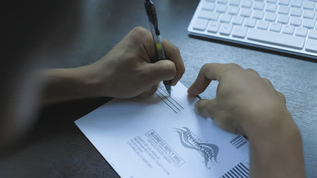 man filling out an absentee ballot - ballot box stock videos & royalty-free footage