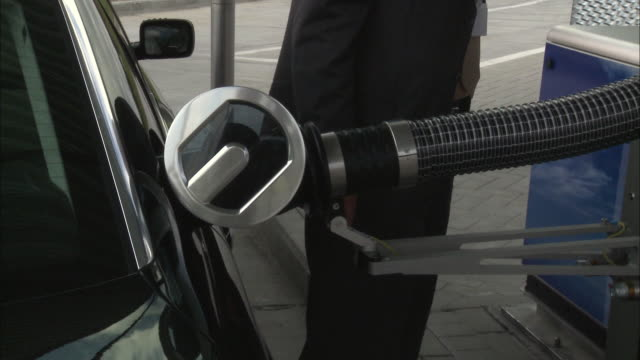 cu, man filling up car on hydrogen station, mid section, brussels, belgium - refuelling stock videos & royalty-free footage