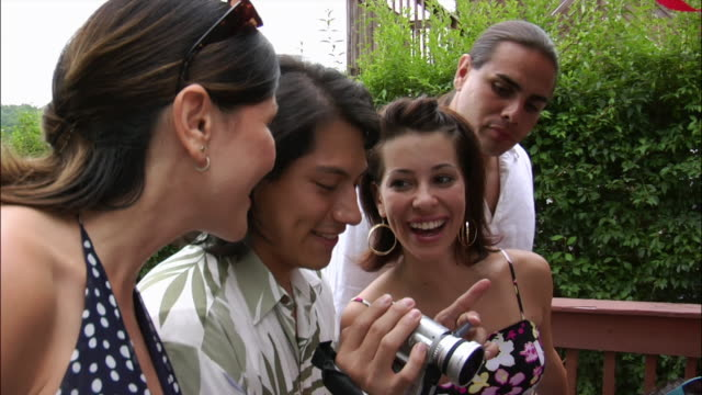 man filming home movies with digital camcorder at birthday party as people watch nearby / new jersey - digital camcorder stock videos & royalty-free footage