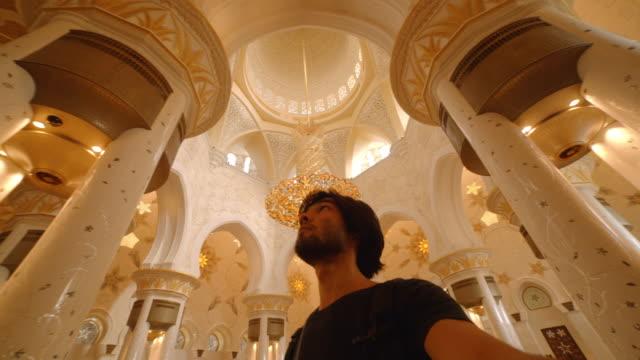 Man films selfie at Grand Mosque, Abu Dhabi