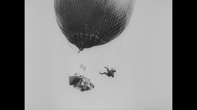 1923 man (buster keaton) finds himself on top a hot air balloon - 1923 stock videos & royalty-free footage