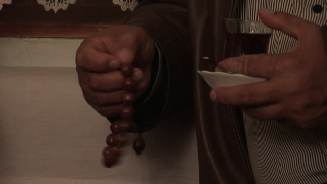 man fingering rosary - rosary beads stock videos & royalty-free footage