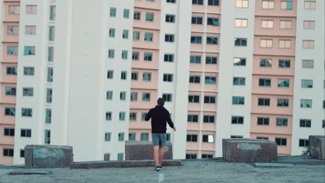 man finishs jogging in urban setting - finishing stock videos & royalty-free footage