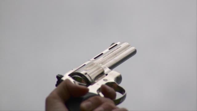 slo mo cu man firing 357 magnum gun, stowe, vermont, usa - stowe vermont stock videos & royalty-free footage