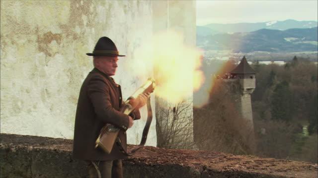 ms man firing gun during christmas gun salute at hohensalzburg fortress / salzburg, austria - austrian costume stock videos and b-roll footage