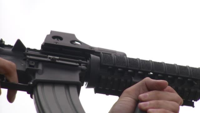 cu la man firing m4 rifle, stowe, vermont, usa - stowe vermont stock videos & royalty-free footage