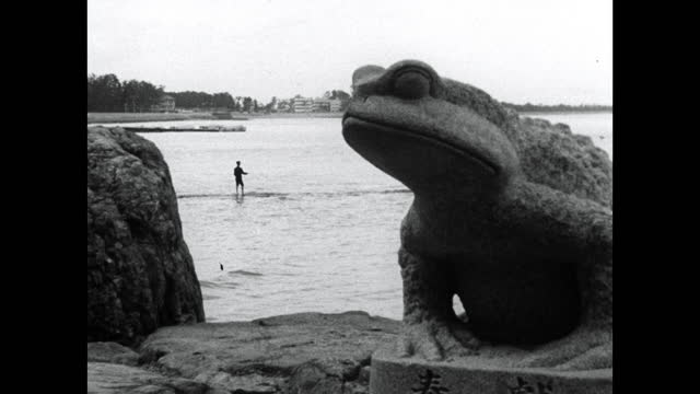 man fishes from the shore in ise, japan; 1964 - brandungsfischen stock-videos und b-roll-filmmaterial