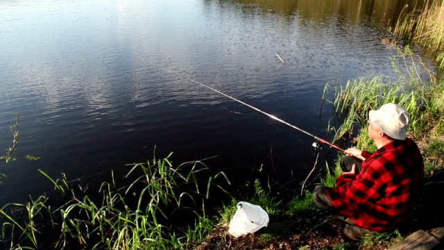 man fishing at the lake - rod stock videos and b-roll footage