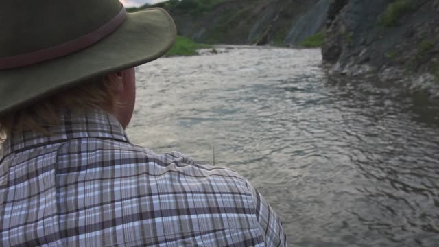 man fishing in river at sunset - only mature men stock videos & royalty-free footage