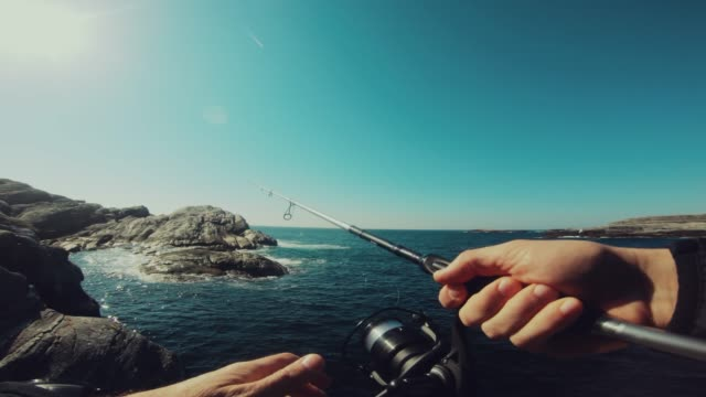 pov man fishing in the sea - summer stock videos & royalty-free footage