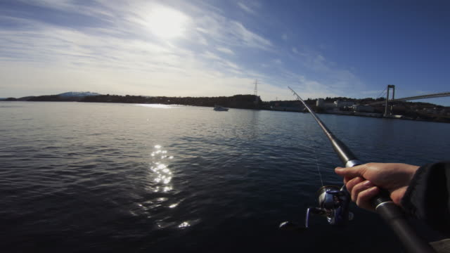 pov man fishing in the sea with a rod - fishing rod stock videos & royalty-free footage