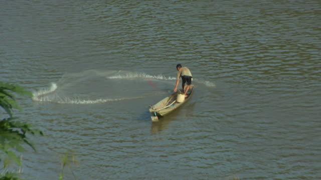 HA SLO MO Man fishing Mekong River / Luang Prabang, Laos