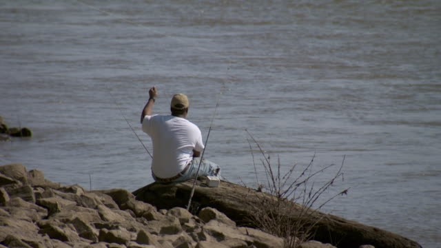MS Man fishing on mississippi river / Memphis, Tennessee, United States